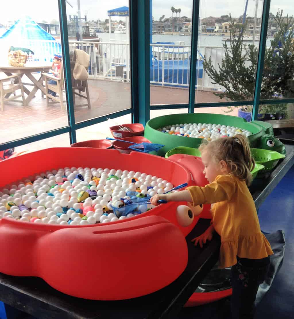Girl playing at Discovery Cube Ocean Quest in Newport Beach
