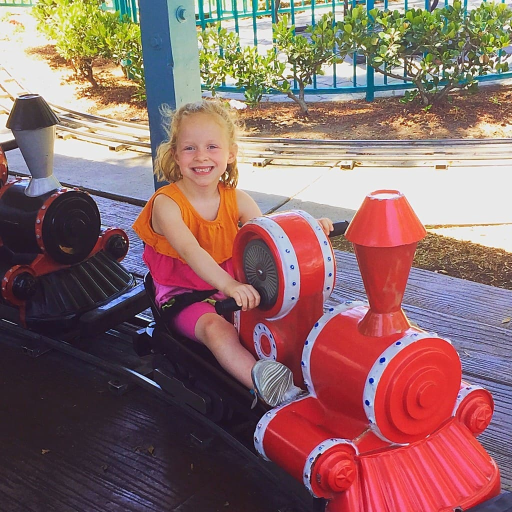 Top 5 Reasons to Visit Adventure City in Anaheim, California including free parking, theme rides for all ages, inexpensive birthday parties, Thomas The Train play area and only $19.95 for admission!