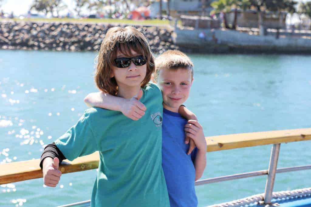 Children going whale watching in California