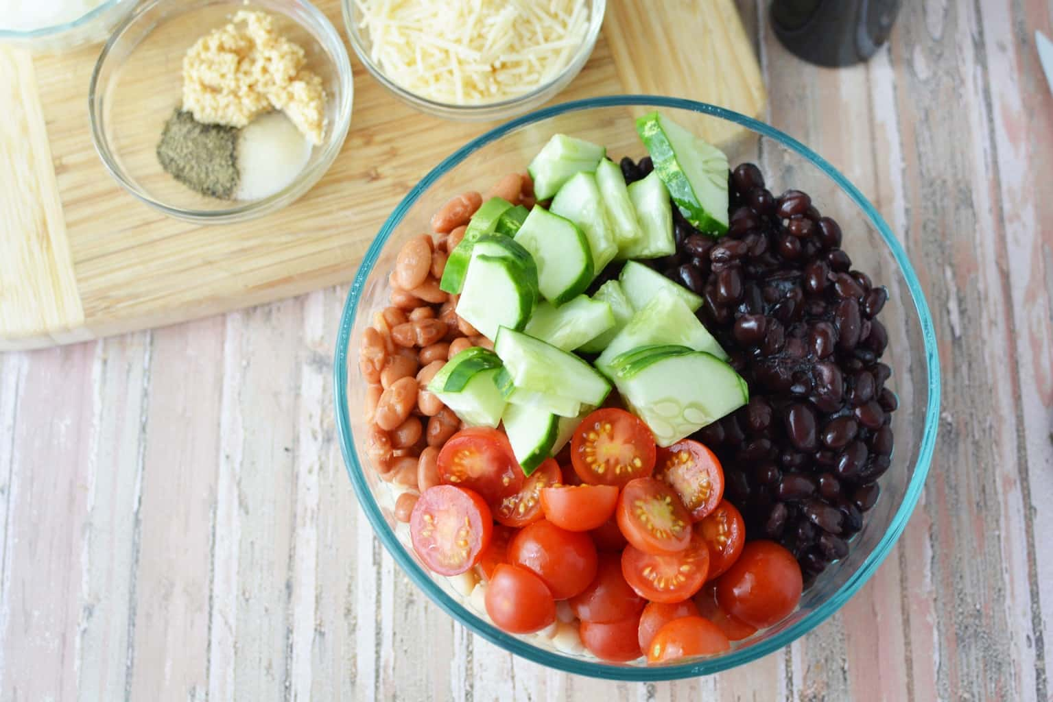 Are you planning a game day or super bowl party? This Easy Cold Bean Salad has the taste of 'mush' beans along with the crunch of an onion and a cucumber.  It also has a balsamic-y taste because of the vinegar, but it's not too strong.