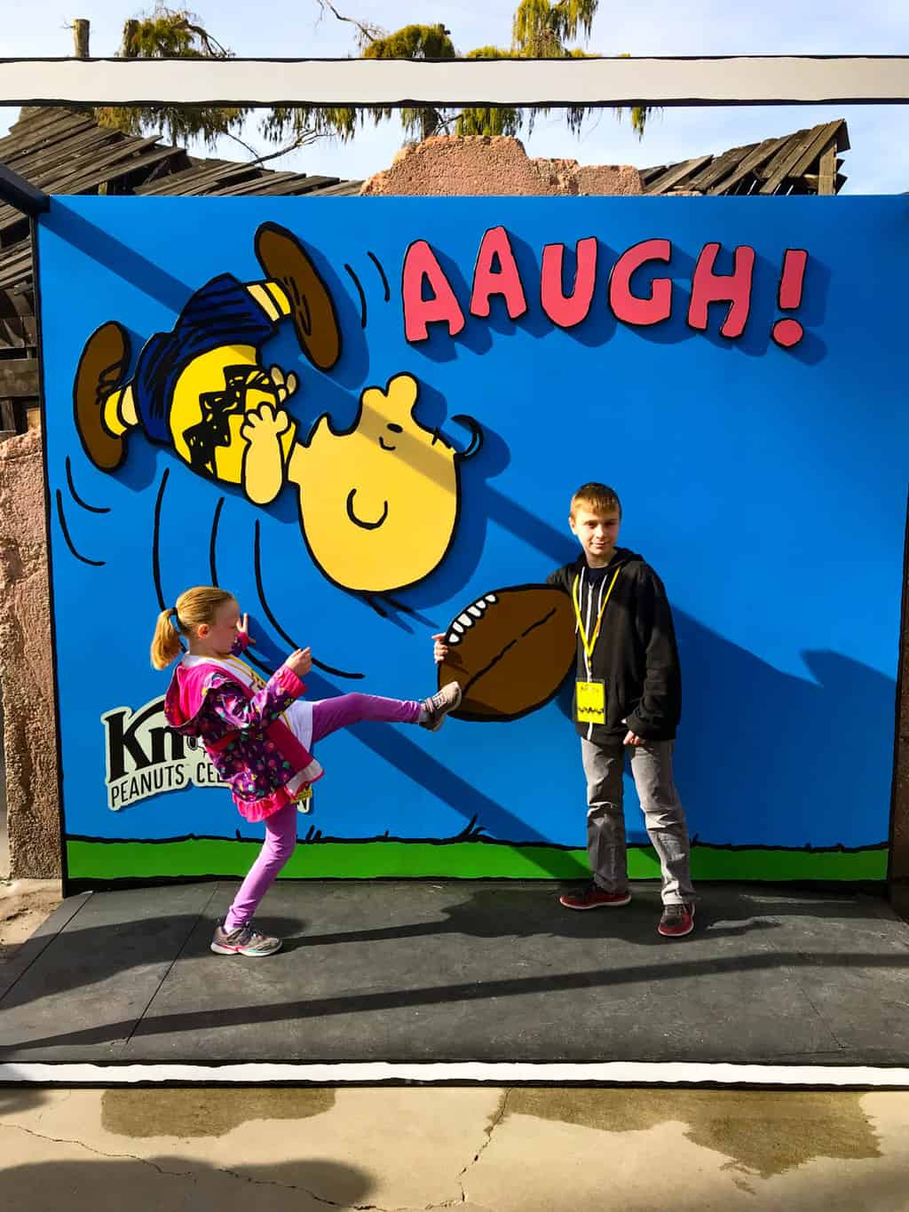 Children kicking Charlie Brown's football during Knott's PEANUTS Celebration.