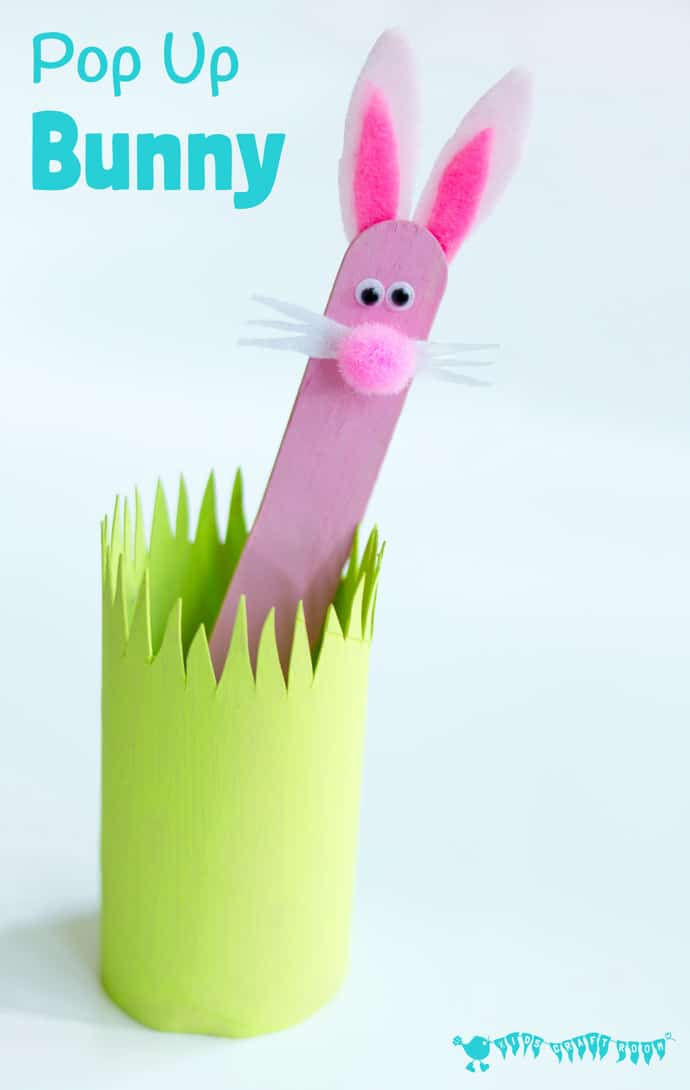 pink popsicle stick bunny craft in green grass