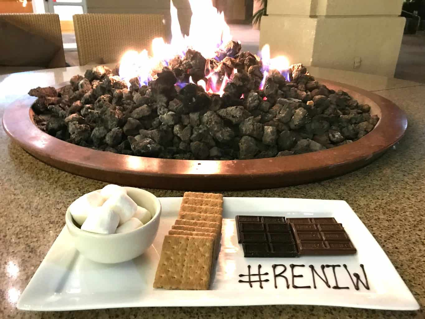 Making s'mores around the fire pit at Renaissance Indian Wells Resort & Spa