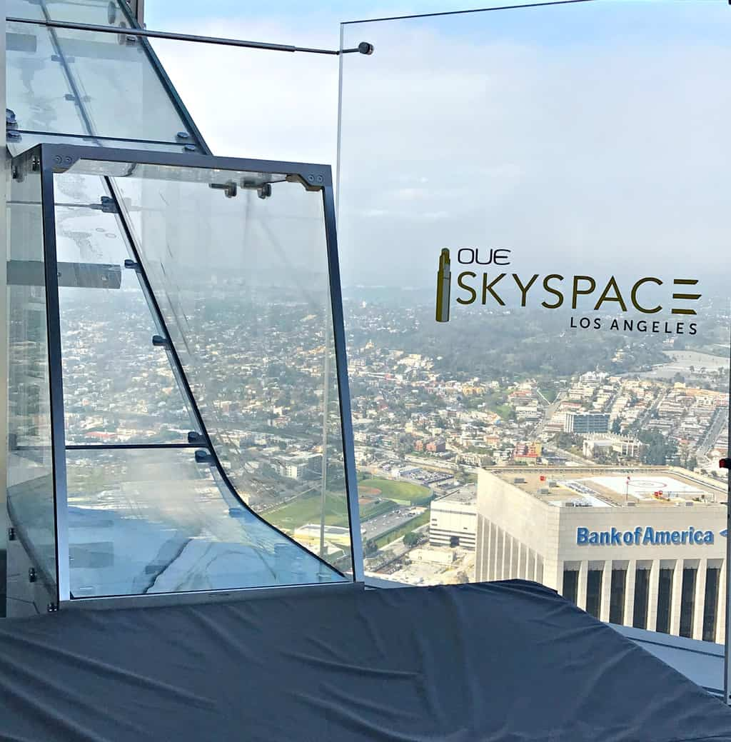 Are you an adventurous person looking for a fun time in Los Angeles?  If so, you should take a ride down the glass slide at Skyspace LA, the tallest open-air observation deck in California.  OUE Skyspace LA is a one-of-a-kind slide that goes along the outside of the iconic U.S. Bank Tower.  It's located approximately 73 stories tall and 1,000 feet above the ground.