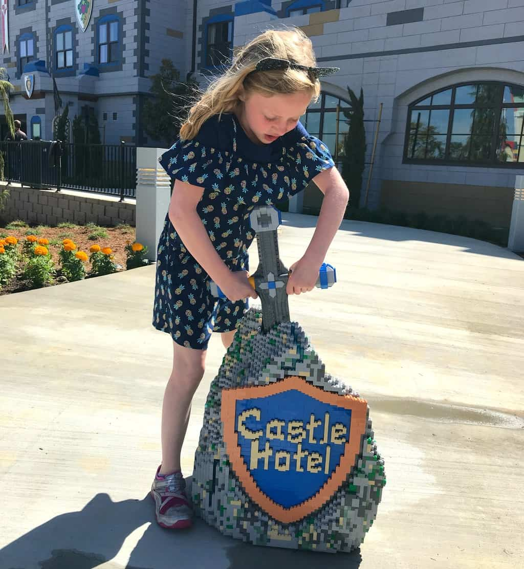 Girl standing in front of LEGOLAND Castle Hotel California