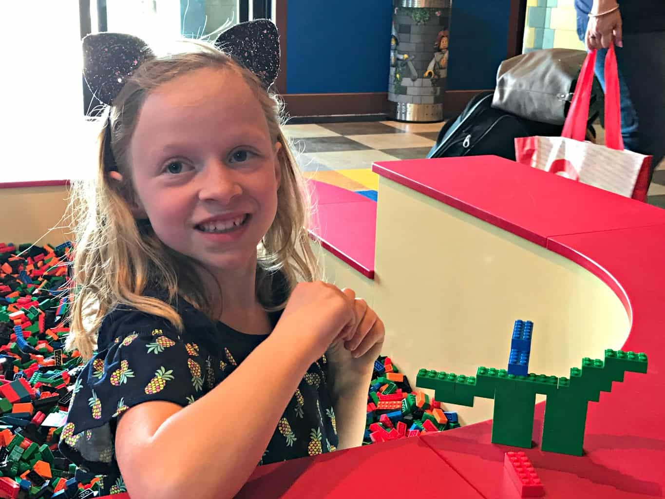 Girl playing with legos at LEGOLAND Castle Hotel