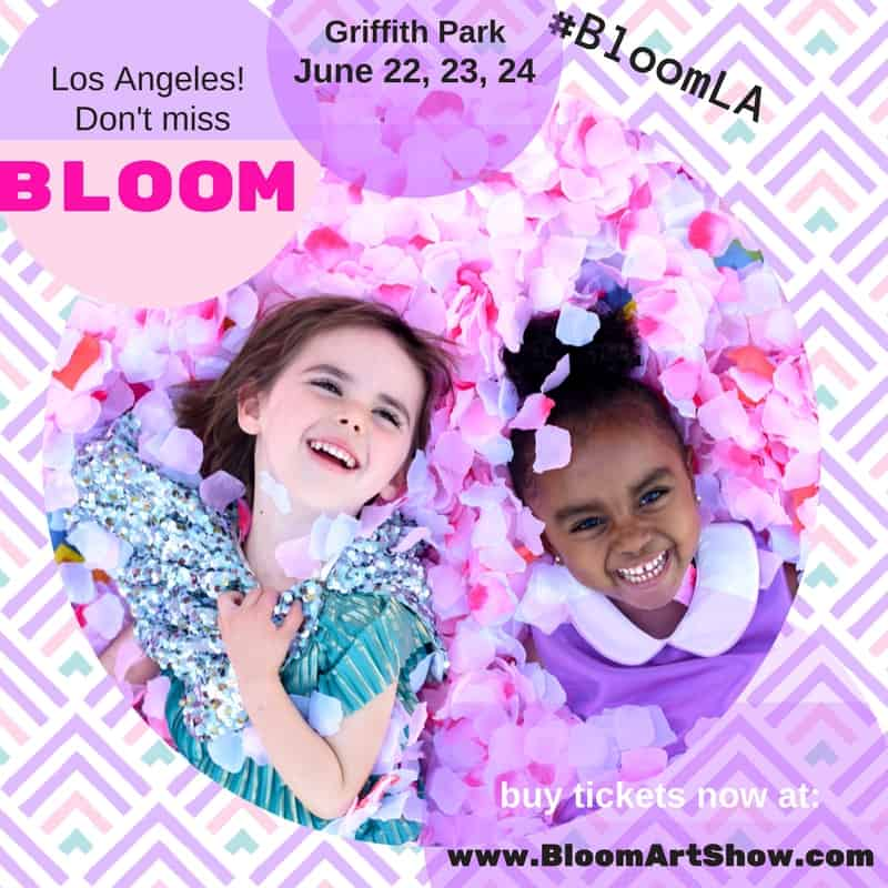 Two girls playing in the flowers at BLOOM LA at Griffith Park.