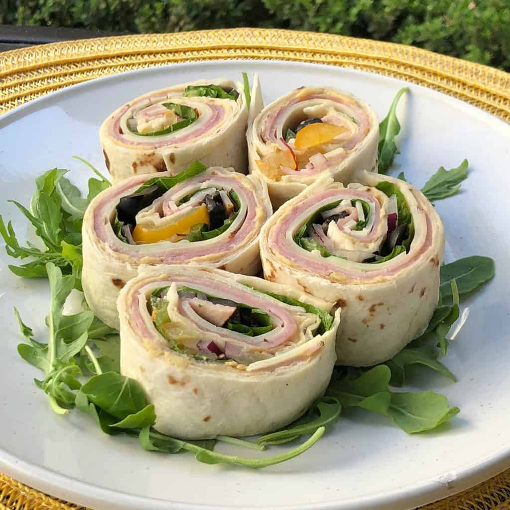 Looking for an alternative to the traditional sandwich? Make these easy Ham and Hummus Roll Ups, which are ideal for school lunches and parties and as a last minute dinner option.