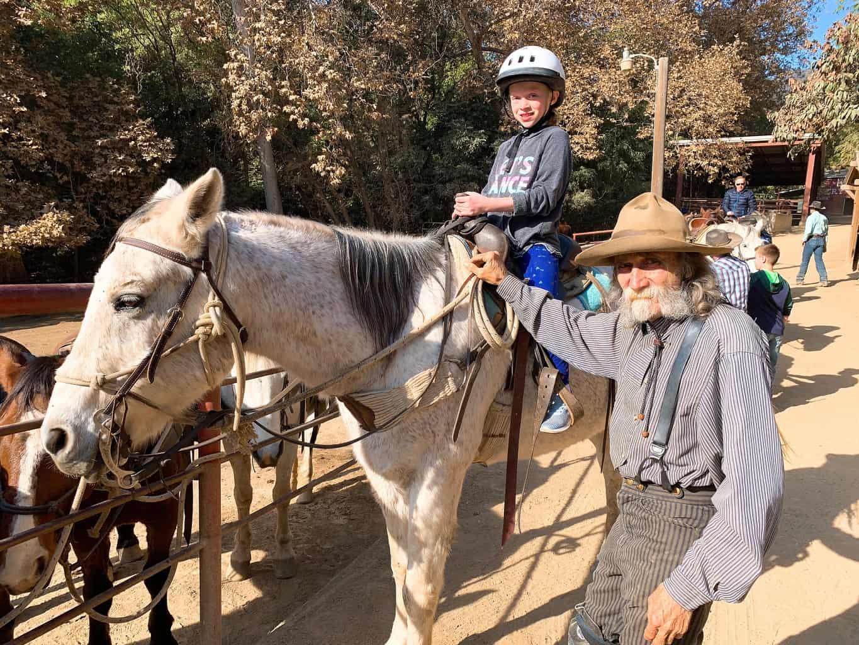 Girl going horseback riding at Circle Bar B Stables Santa Barbara