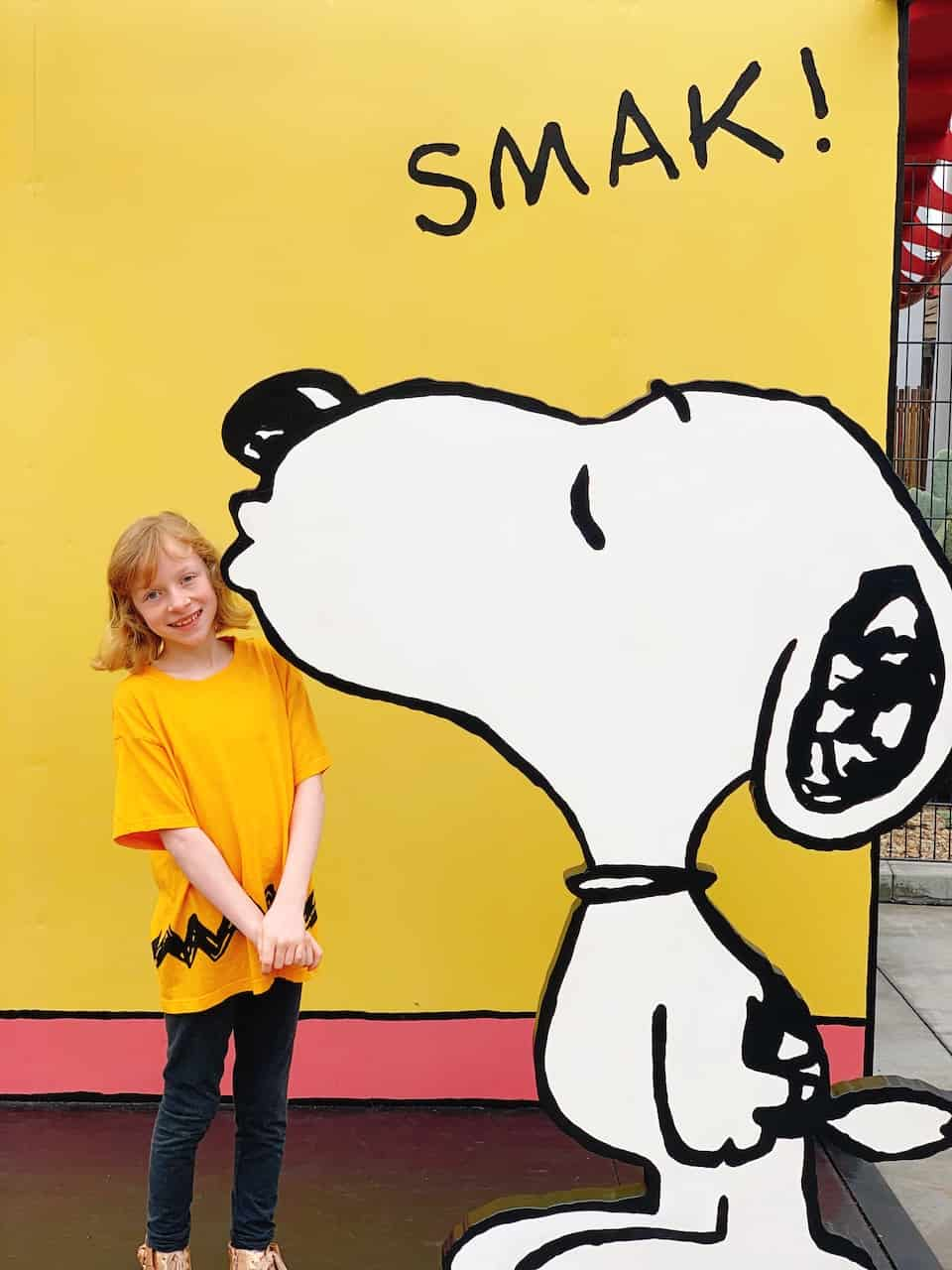 Girl getting kissed by Snoopy at Knott's Berry Farm