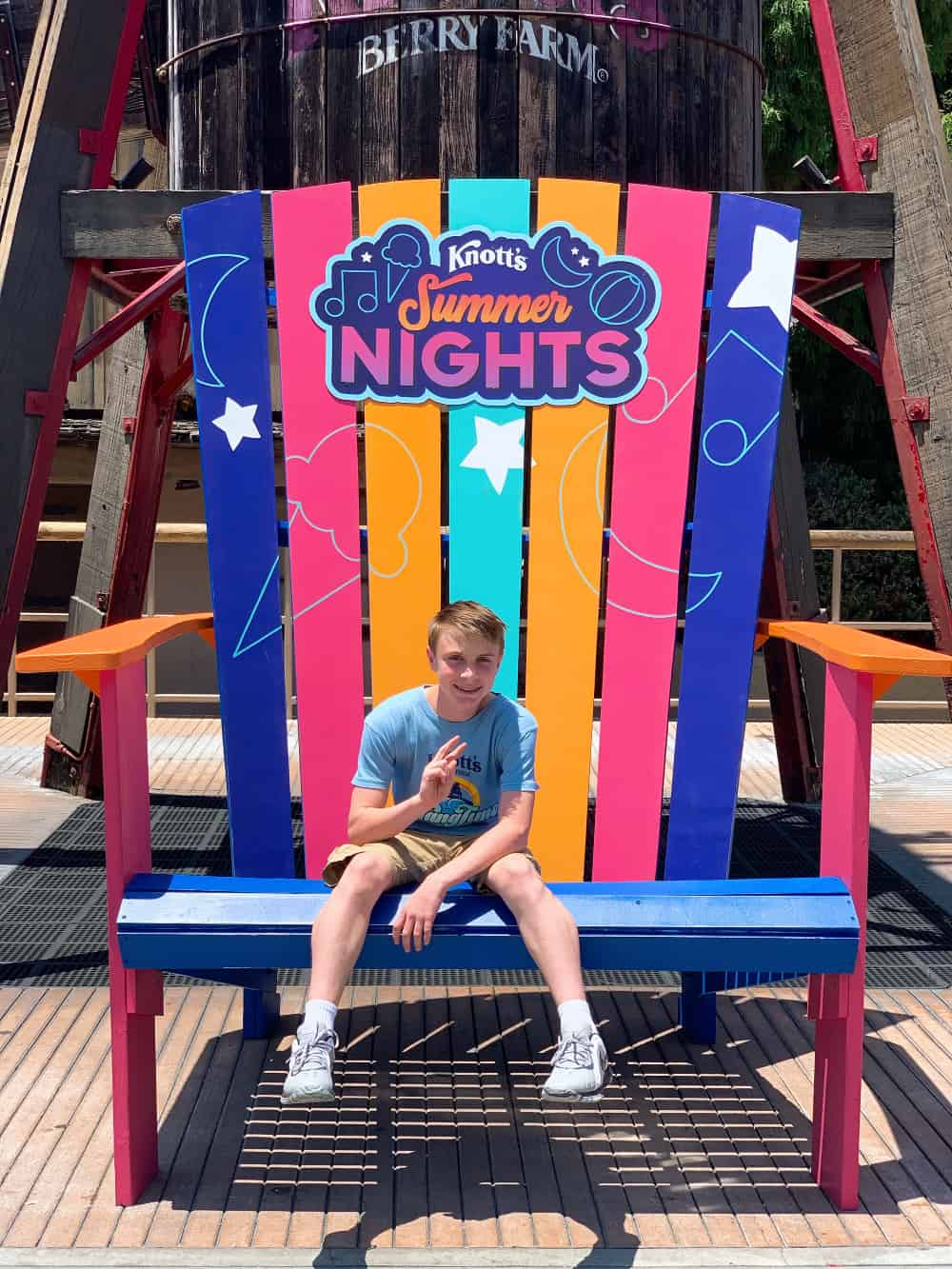 Boy sitting on a chair at Knott's Summer Nights
