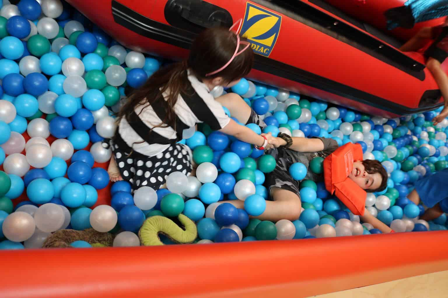 Girl and boy in ball pit at Cayton Children's Museum in Santa Monica