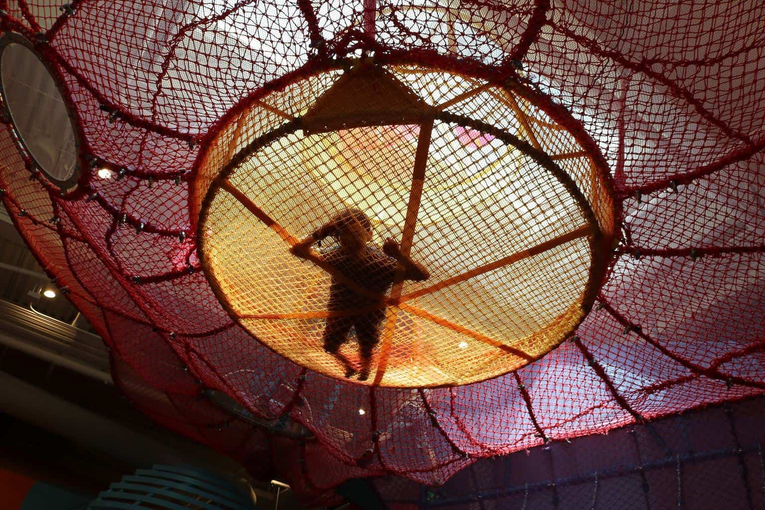 children playing on the spider ball at Cayton Children's Museum in Santa Monica