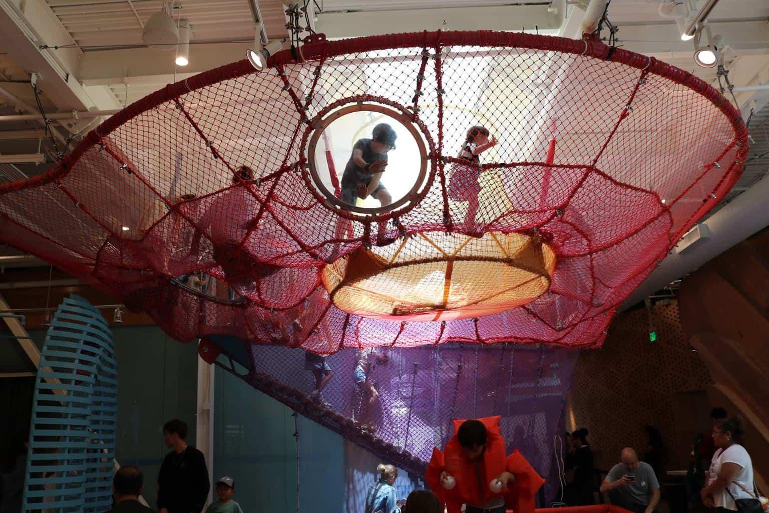 children climbing on the spider web at Cayton Children's Museum Santa Monica