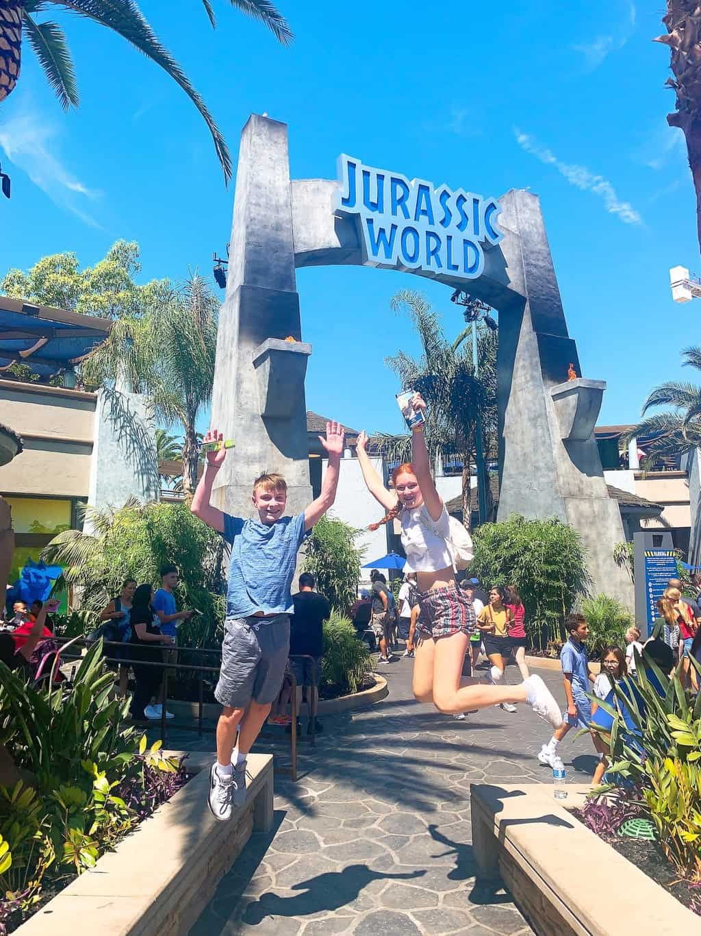a boy and girl jumping at Jurassic World The Ride Universal Studios Hollywood