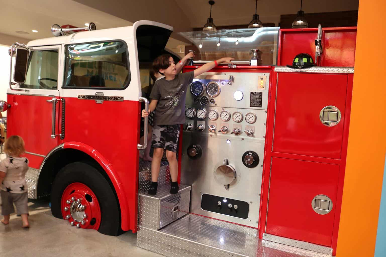 Boy playing inside a fire truck at Cayton Children's Museum in Santa Monica