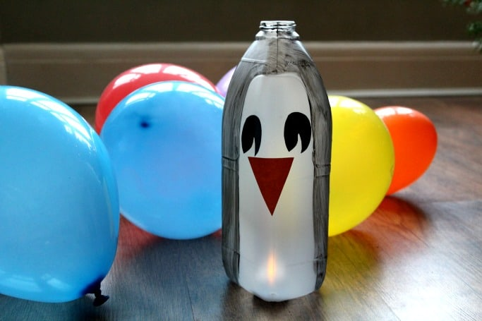 easy penguin kids craft made out of a milk bottle