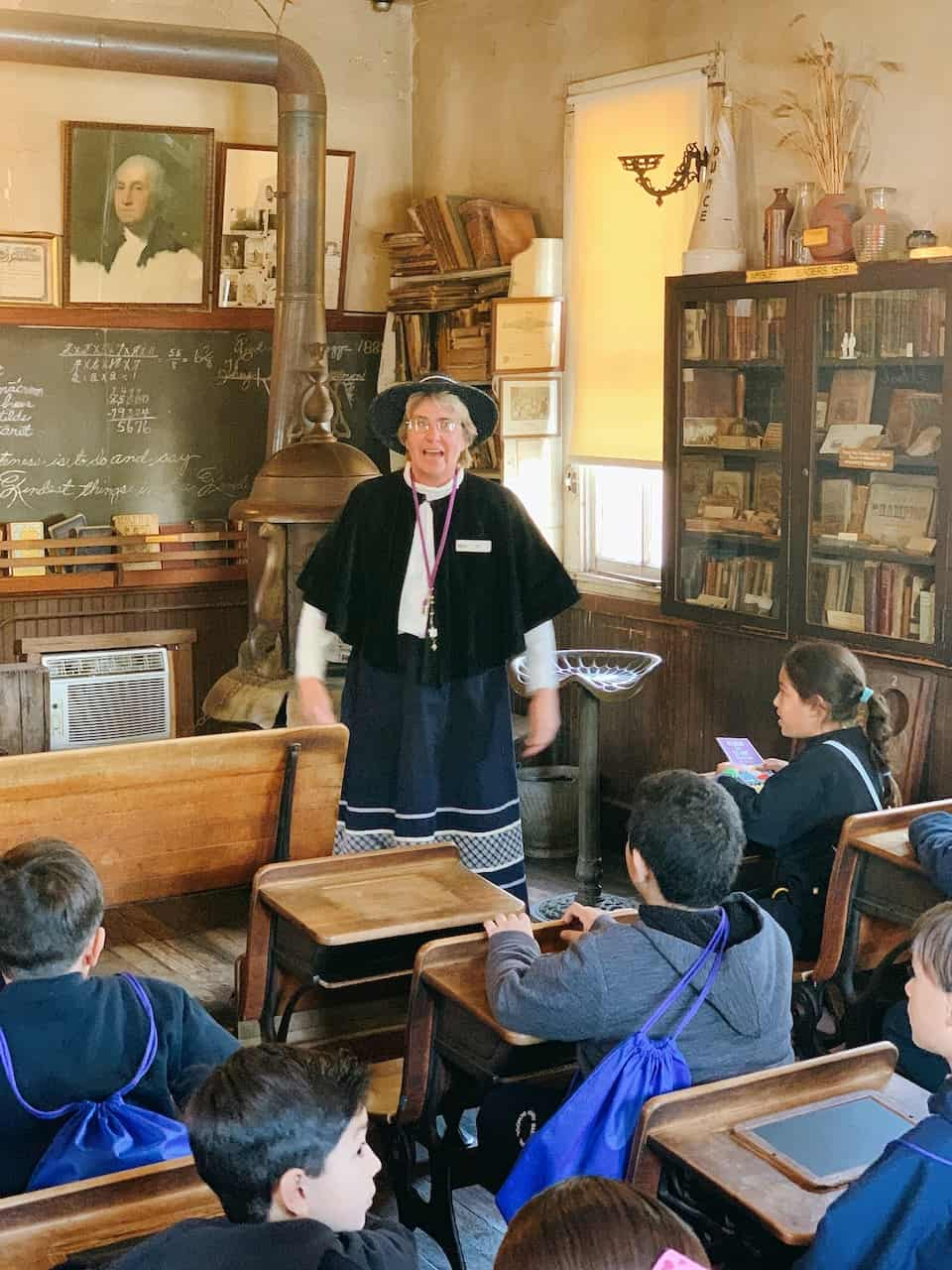 Lady explaining California history in a one room school house in Buena Park