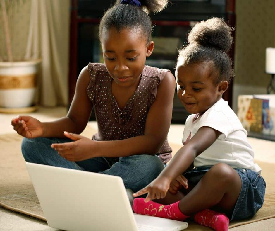 Girls watching a movie on a virtual playdate with friends