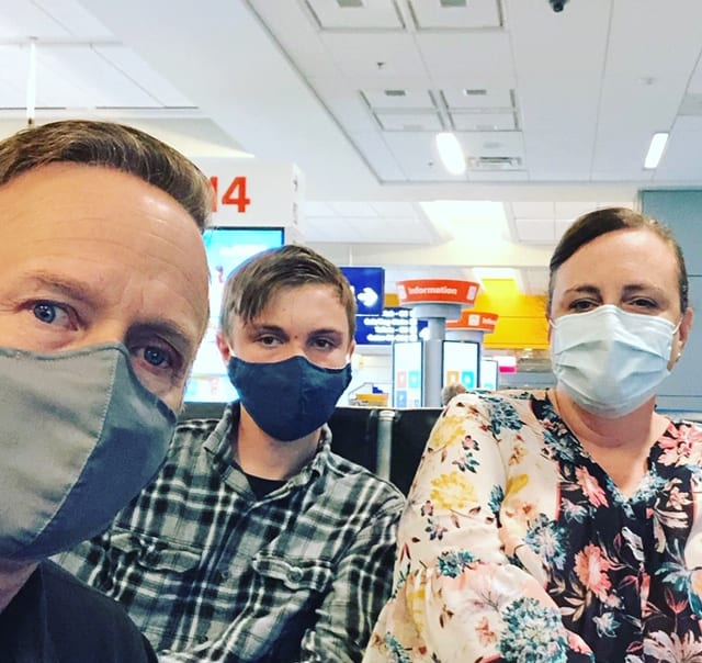 a family flying on an airplane during a pandemic