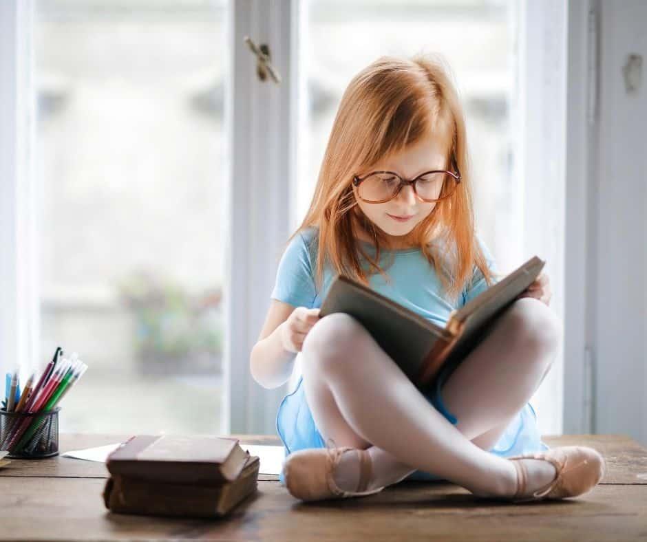 Little girl using a free homeschool reading program