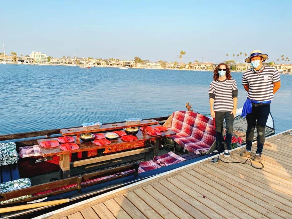 Two men leading a gondola ride in Long Beach